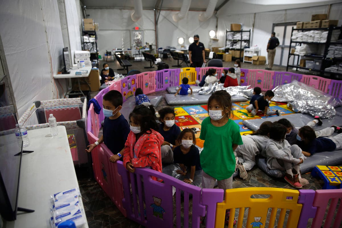 New photos shows migrant children crowded into single playpen at US-Mexico border
