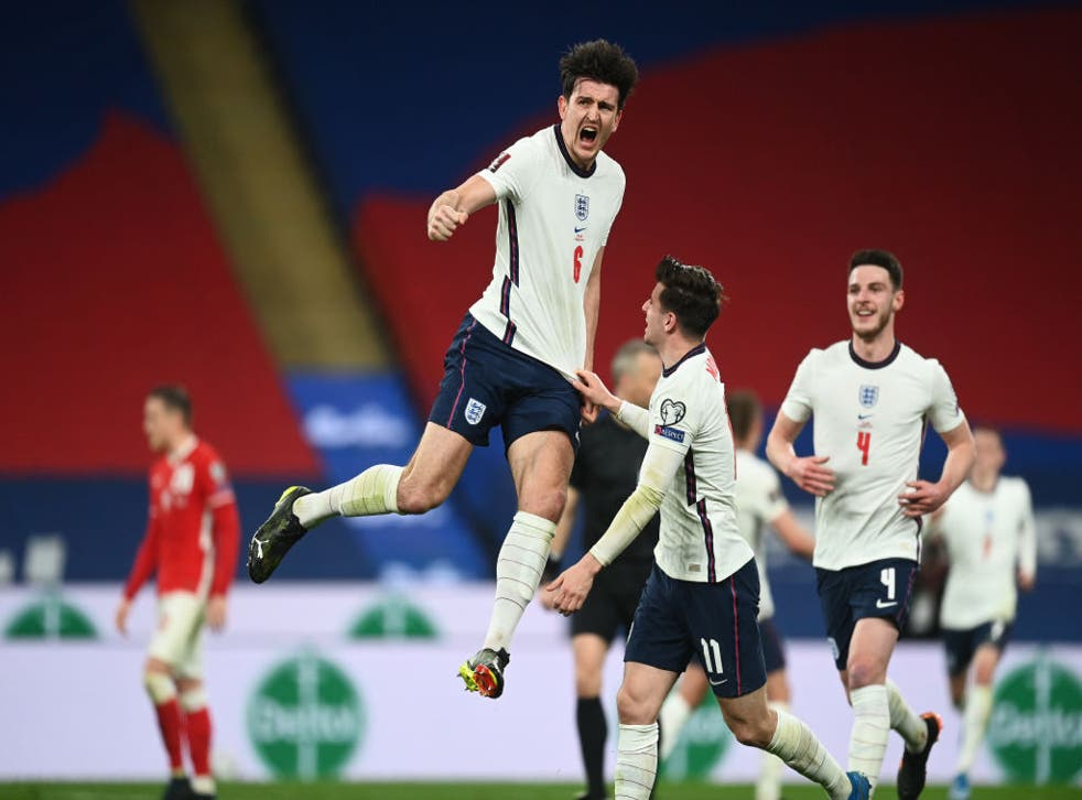 <p>Maguire celebrates his goal for England</p>