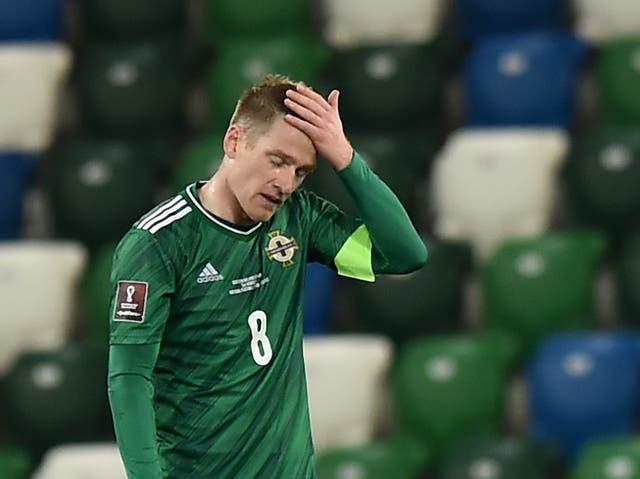 <p>Steven Davis reacts to Northern Ireland's draw</p>