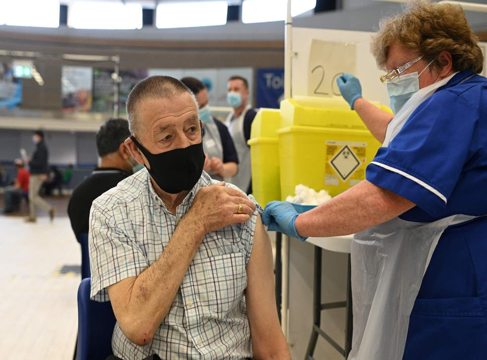 <p>A dose of the Pfizer Covid-19 vaccine  is administered at a clinic in the Derby Arena</p>
