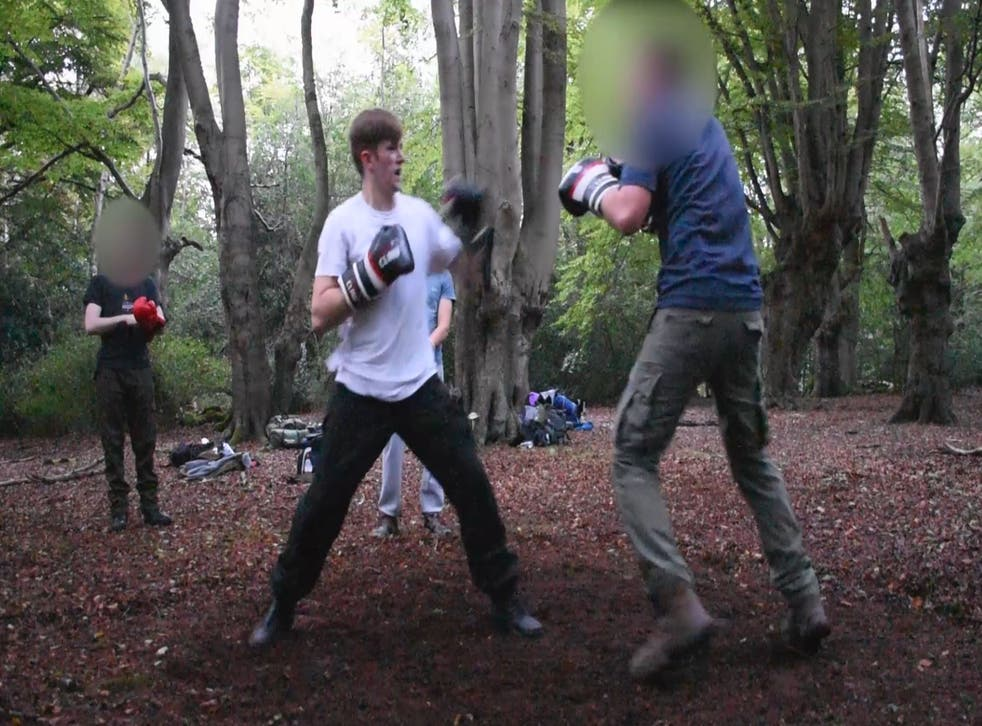 <p>Benjamin Hannam, pictured here boxing outdoors, is now the first police officer to be convicted of belonging to a banned neo-Nazi terror group.</p>