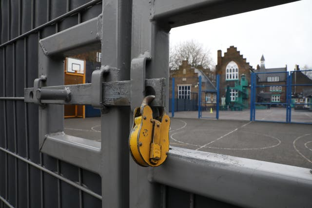 File photo of a lock hanging on a school gate in London