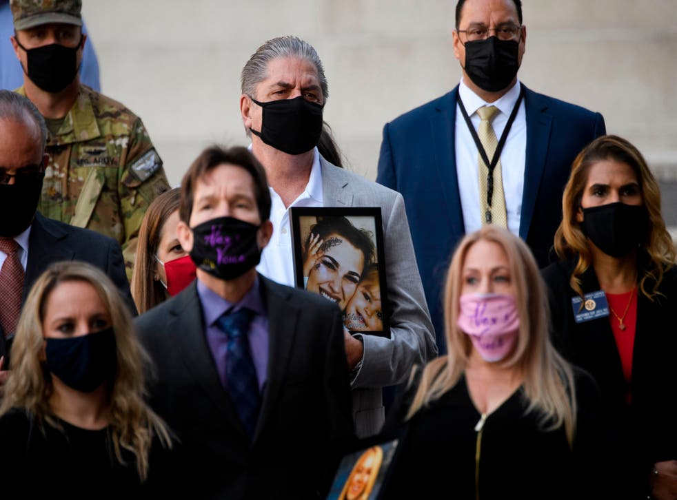 Steve Filson, whose daughter Jessica Filson died in January 2020 of opioids, stands with families who have had relatives die of opioids and authorities during a news conference outside the Roybal Federal Building on February 24, 2021 in Los Angeles, California.