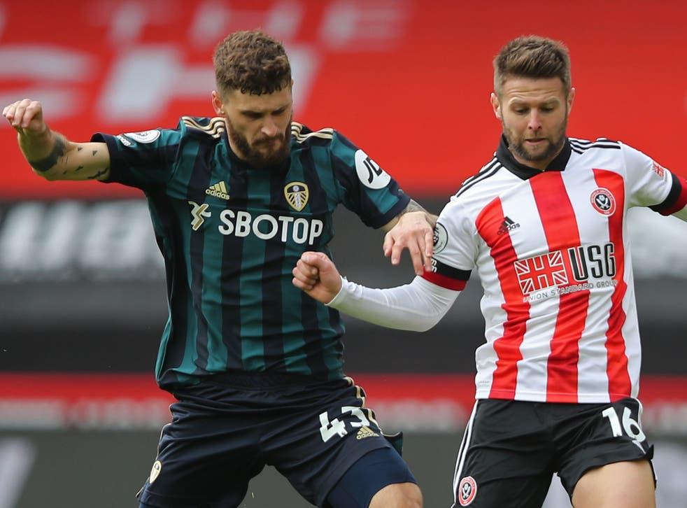 Leeds' Mateusz Klich (left) challenges Sheffield United's Oliver Norwood