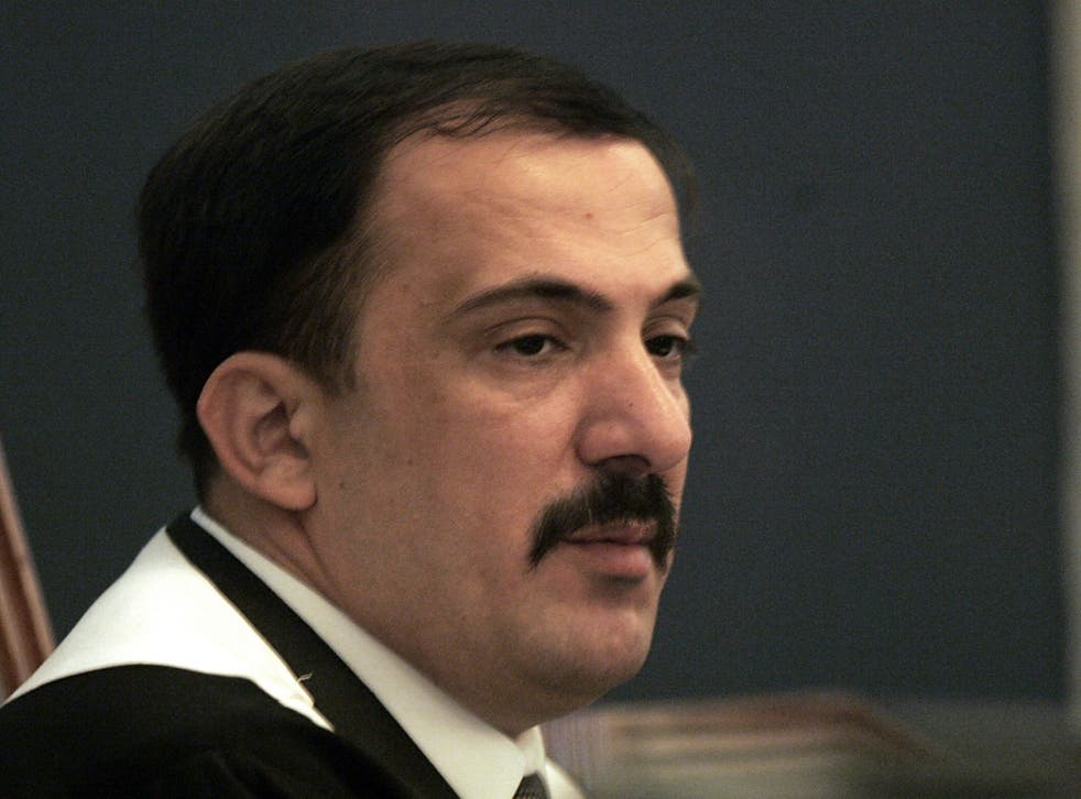 Virus Outbreak-Iraq-Saddam's Judge