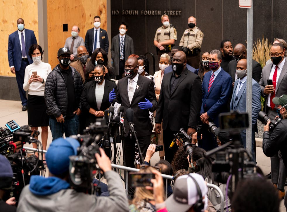 <p>MINNEAPOLIS, MN - SEPTEMBER 11: Attorney Ben Crump (C), surrounded by family of George Floyd, speaks to media gathered outside the Hennepin County Family Justice Center after a pretrial hearing for the four former Minneapolis Police officers charged in the death of George Floyd on September 11, 2020 in Minneapolis, Minnesota. Crump is representing George Floyd's family. </p>