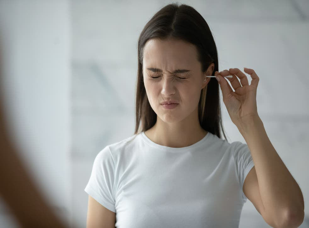 Person cleaning their ears
