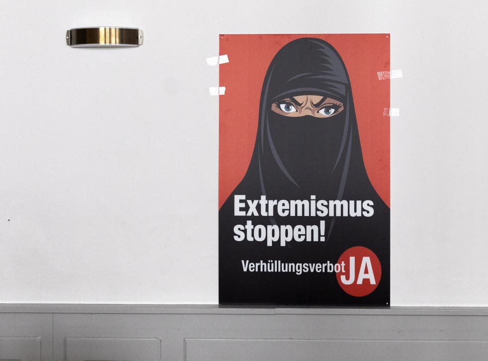<p>A poster saying 'Stop Extremism' hangs on a wall at the meeting place of the supporters of the burqa ban initiative, in Bern</p>