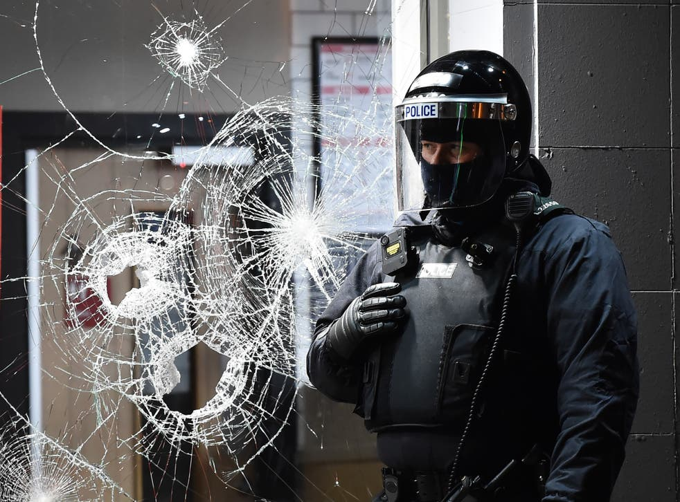<p>Bricks, bottles and fireworks were thrown at police on Friday</p>