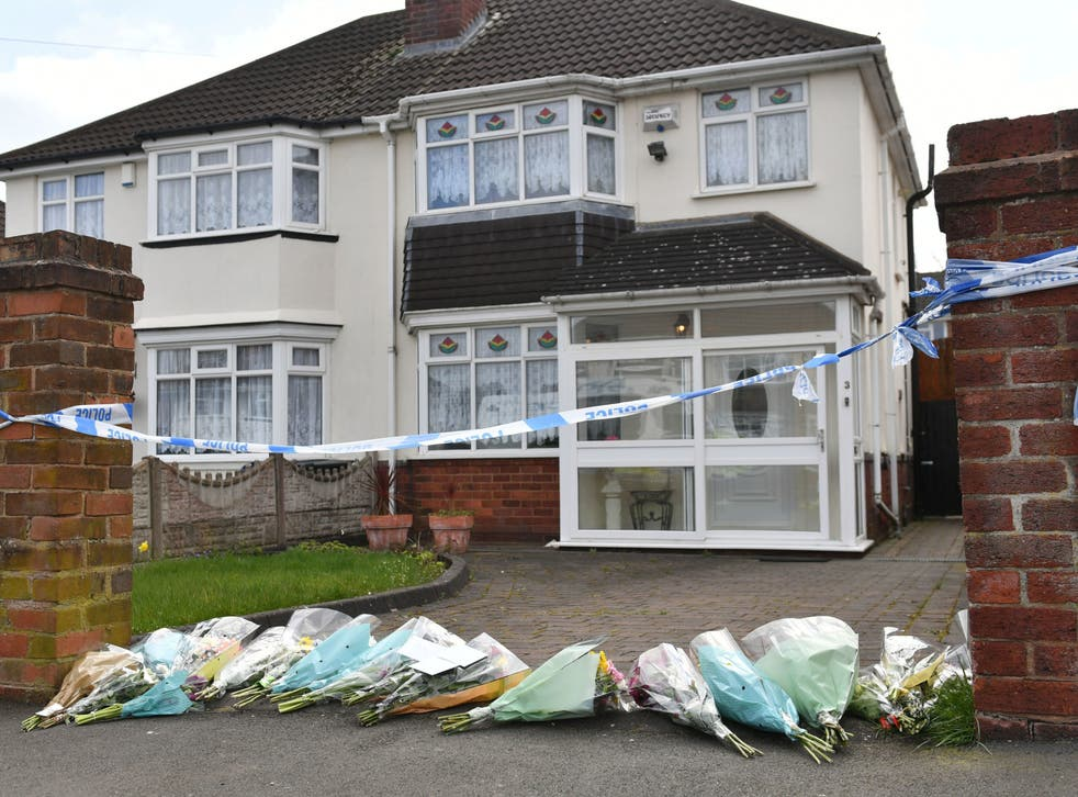 <p>Flowers have been laid at the scene where Ms Downer died after being attacked by two dogs</p>