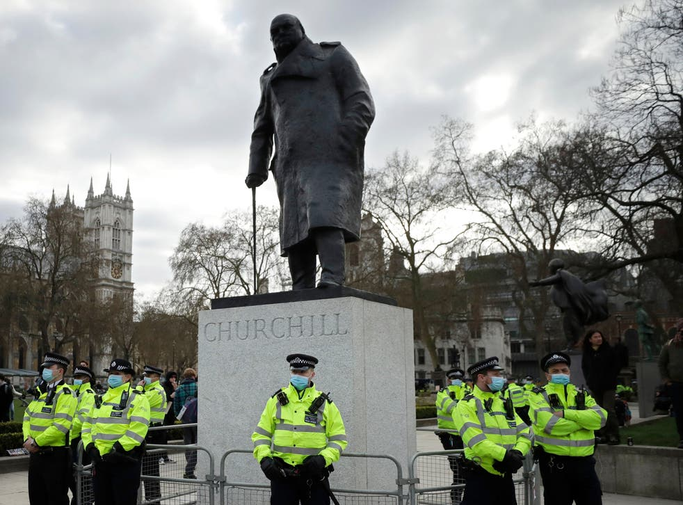 Police stand guard around the statue of wartime prime minister Winston Churchill in Parliament Square