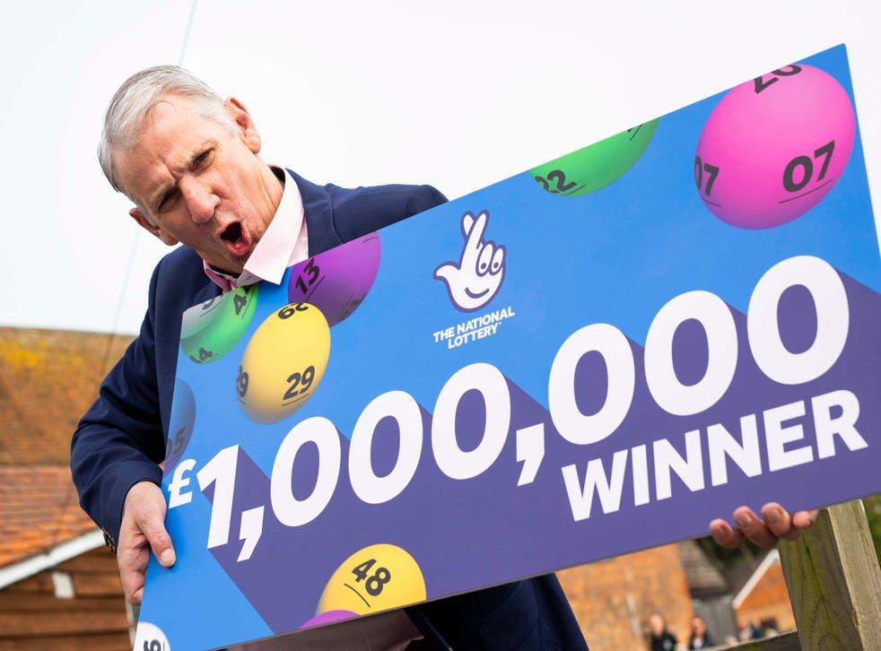 John McFadden from Southampton celebrates winning £1m on a National Lottery scratchcard
