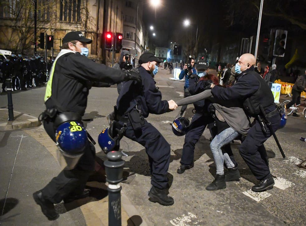 <p>Police officers arrest a protester during a Kill The Bill demonstration in Bristol this week</p>
