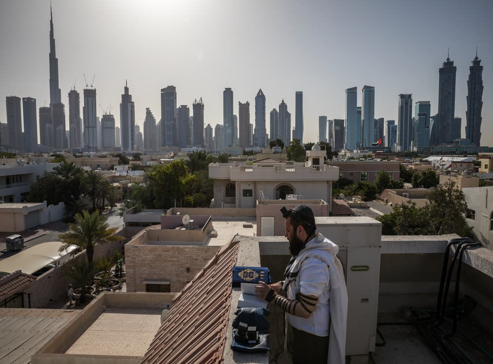 <p>Rabbi Levi Duchman performs morning prayers on the roof of the Jewish Community Center of the UAE</p>