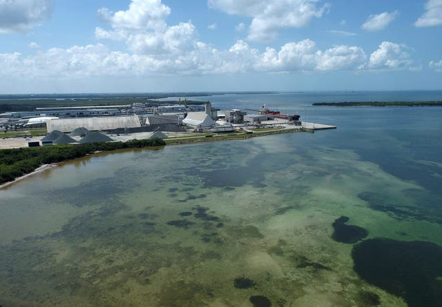 <p>Drone picture of old Piney Point phosphate mine shows a large pond of wastewater that has threatened to flood roads and burst a system that stores polluted waters</p>