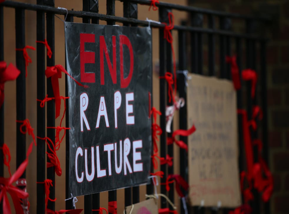 <p>A placard saying 'End Rape Culture' attached to the fence outside James Allen's Girls' School in London</p>
