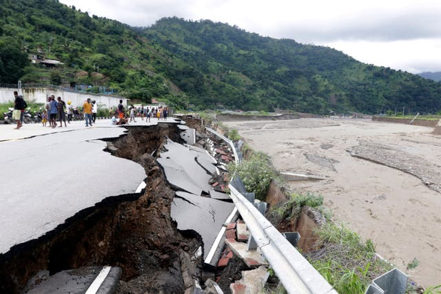 <p>Roads caved in, bridges collapsed and dams overflowed after flash floods pounded Indonesia and Timor-Leste</p>