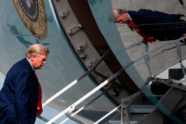 <p>File Image: The then-US President Donald Trump boards Air Force One while departing from Palm Beach International Airport in December 2020</p>