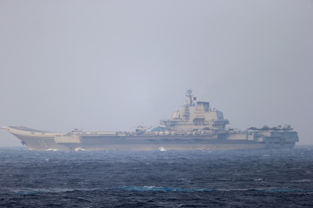 <p>Chinese aircraft carrier Liaoning sails through the Miyako Strait on 4 April, 2021 in this handout photo by the Joint Staff Office of the Defense Ministry of Japan</p>