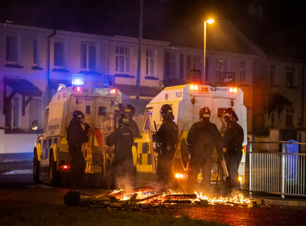 <p>PSNI Tactical Support Group officers in attendance at the loyalist Nelson Drive estate in the Waterside of Derry City, Co. Londonderry, during a public order incident which saw a car being set alight and surrounding roads being blocked with fires</p>