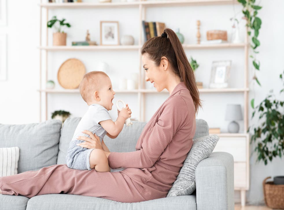 Mum and baby laughing on sofa