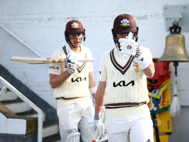 Ollie Pope and Jamie Smith of Surrey in action during a pre-season warm-up match