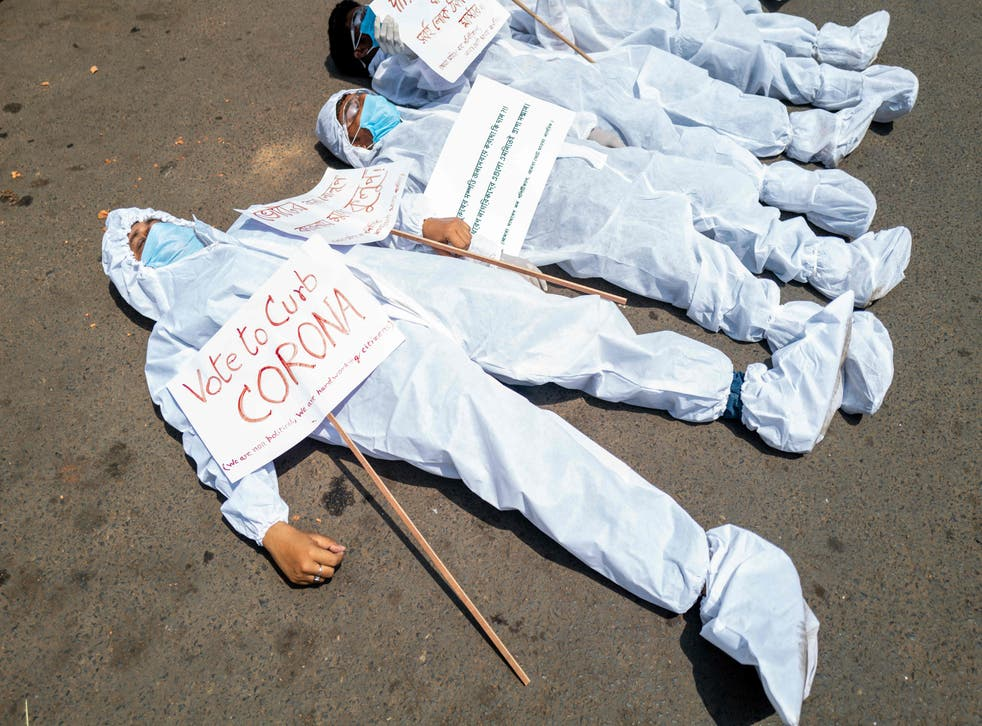 <p>Protesters in Kolkata, definitely not standing up</p>