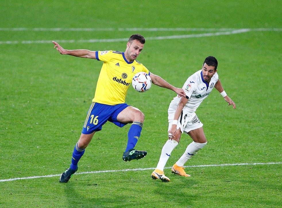 <p>Cadiz player Juan Cala (left)</p>