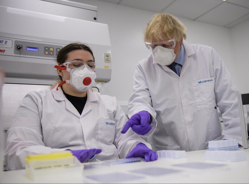 Prime Minister Boris Johnson with  quality control technician Kerri Symington as he visits the French biotechnology laboratory Valneva in Livingston
