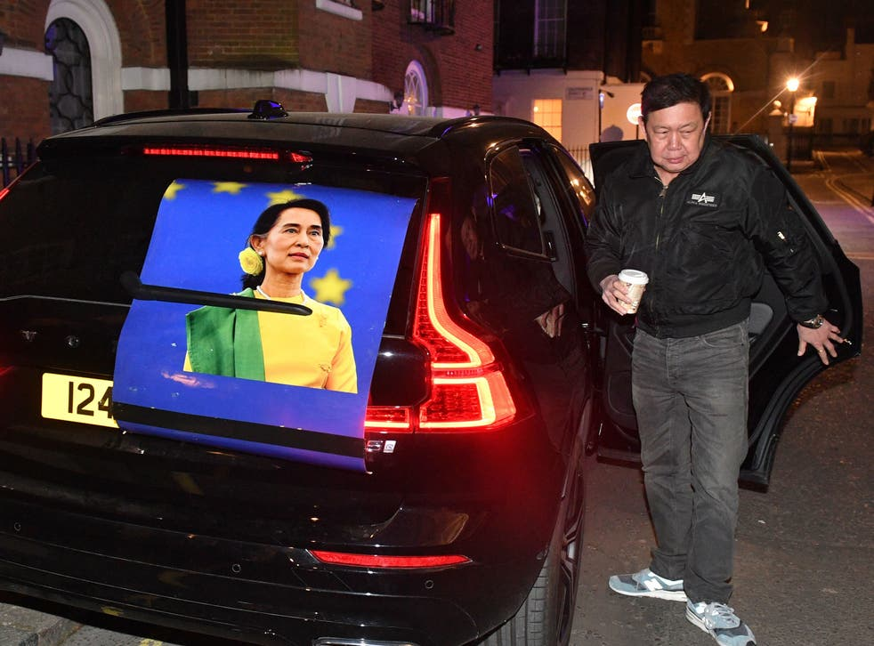 Kyaw Zwar Minn got out of a car bearing a large image of Aung San Suu Kyi