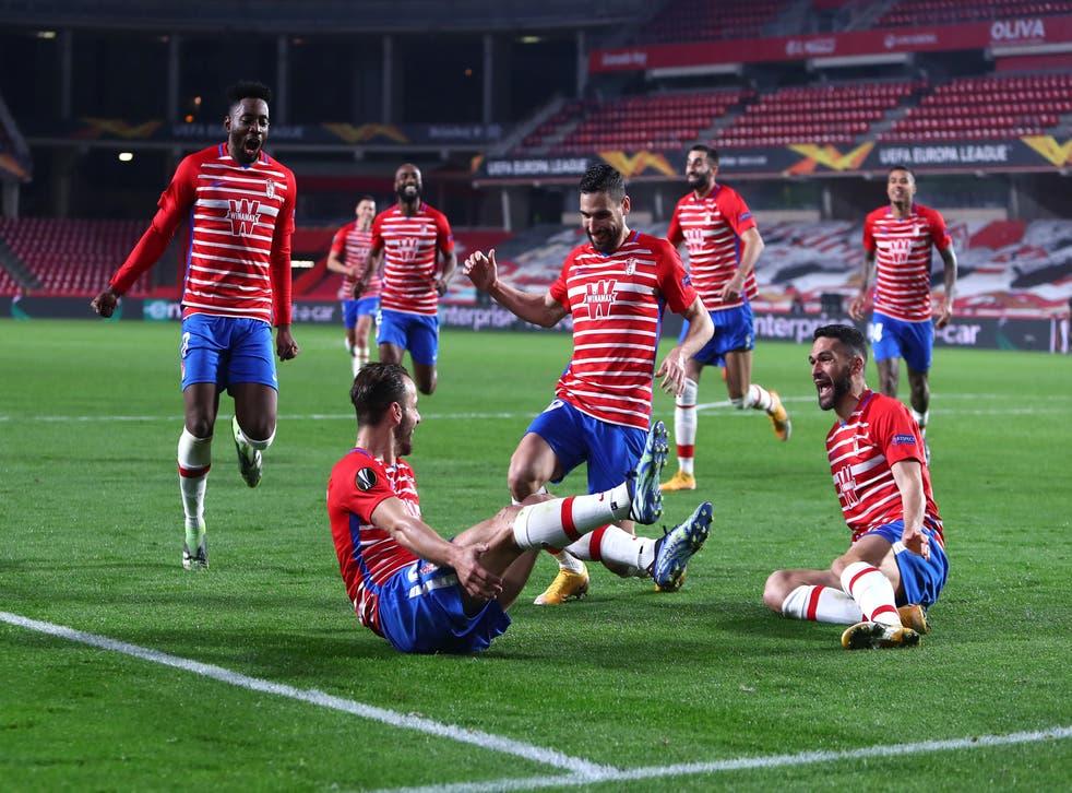 Roberto Soldado of Granada CF celebrates in the Europa League Round of 16