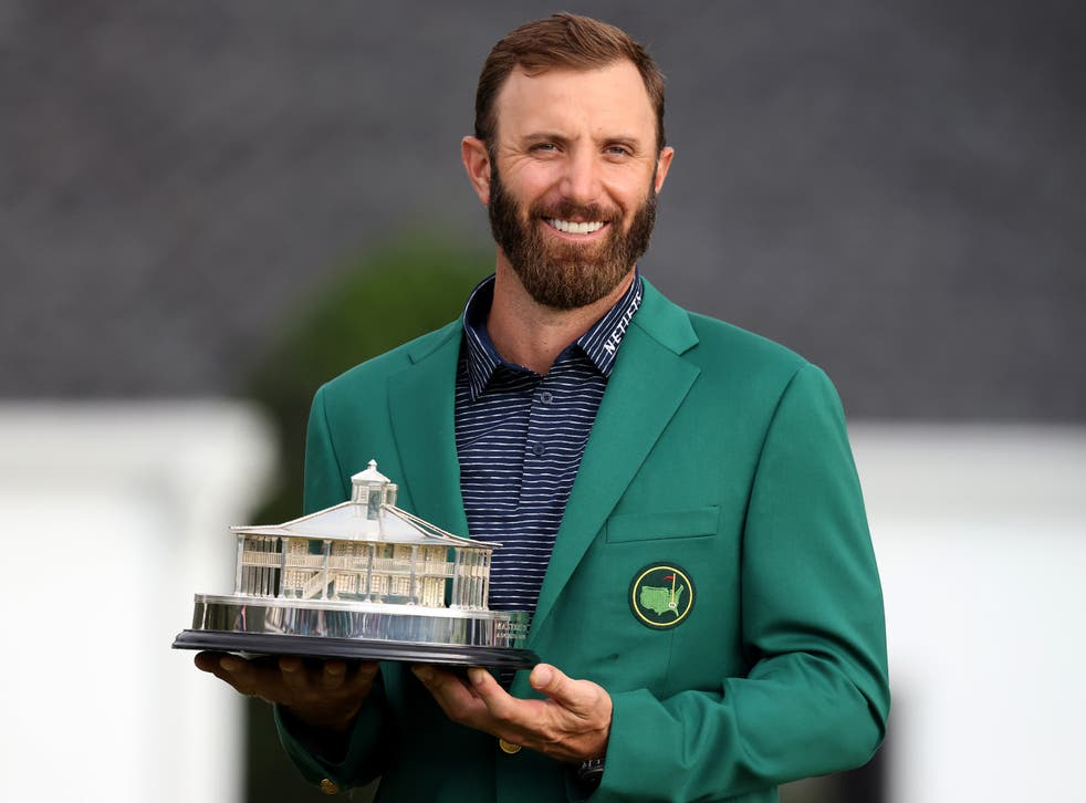 <p>Dustin Johnson poses with the trophy at August in 2020</p>