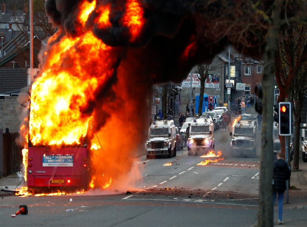 <p>A hijacked bus burns on the Shankill Road as protests continue in Belfast on Wednesday evening</p>