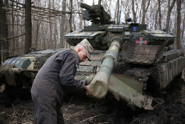 <p>A Ukraine soldier works on his tank, in the Lugansk region, not far from the front line with Russia-backed separatist forces</p>