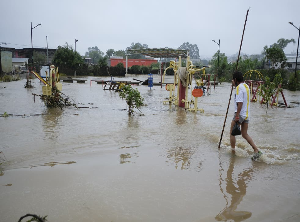 <p>A flooded street in Coban, Guatemala, following a tropical storm</p>