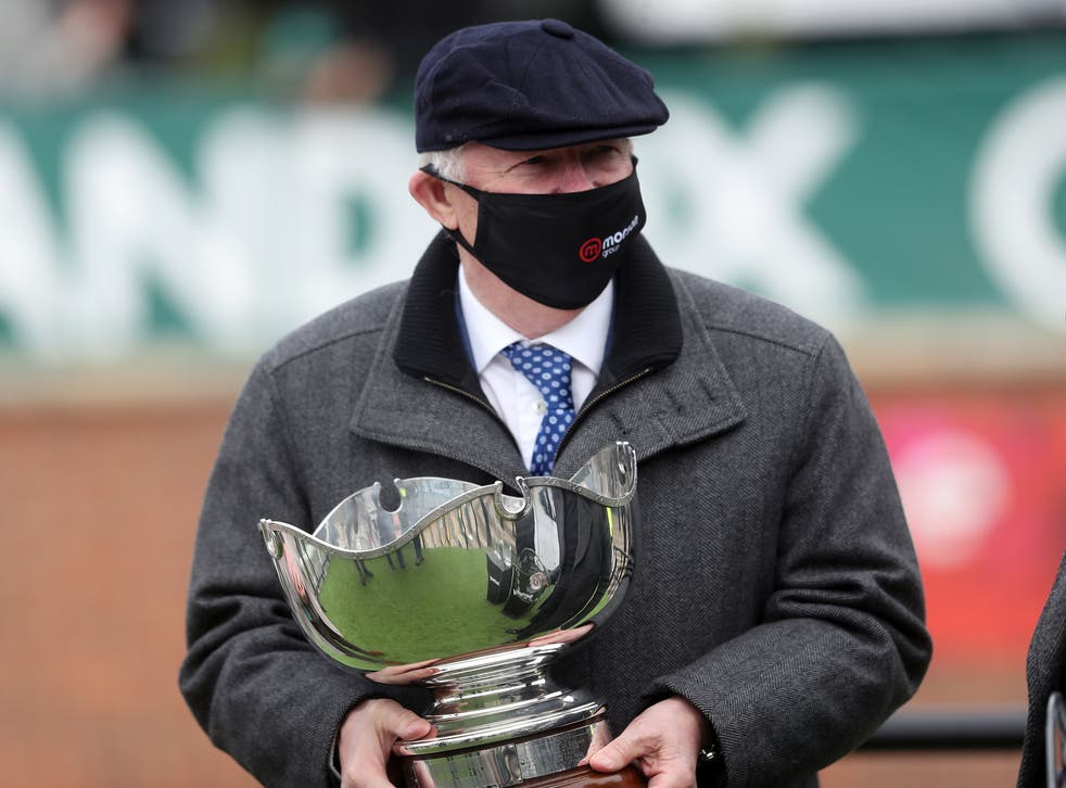 Sir Alex Ferguson with the trophy after Clan Des Obeaux won the Bowl Chase