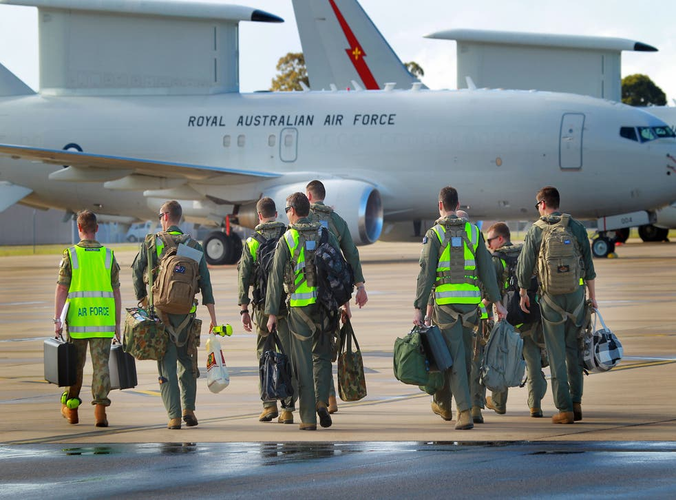 <p>In this handout image provided by Commonwealth of Australia, air crew prepare to board the the E-7A Wedgetail Airborne Early Warning and Control aircraft for deployment to the Middle East on September 21, 2014 in Williamtown, Australia. RAAF has decided to ban gendered terms like 'airmen' and rather use 'aviators' </p>