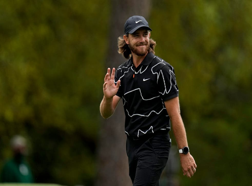 Tommy Fleetwood salutes the crowd after clinching a hole in one