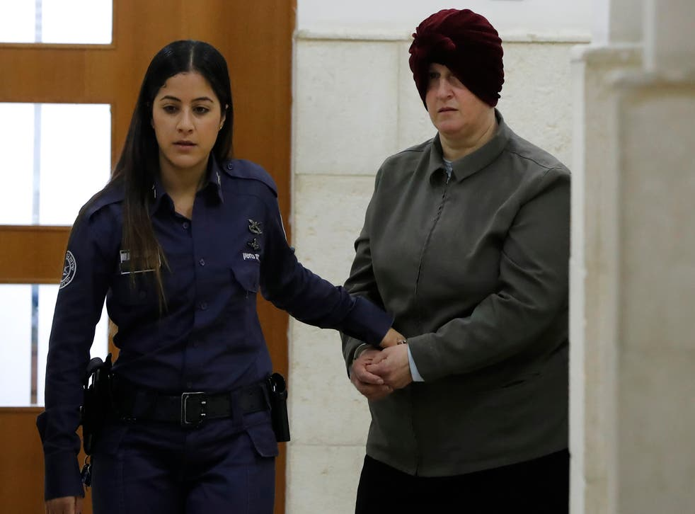 <p>In this file photo taken on 27 February  2018, Malka Leifer, a former Australian teacher accused of sexual abuse of girls at a school, arrives for a hearing at the District Court in Jerusalem</p>