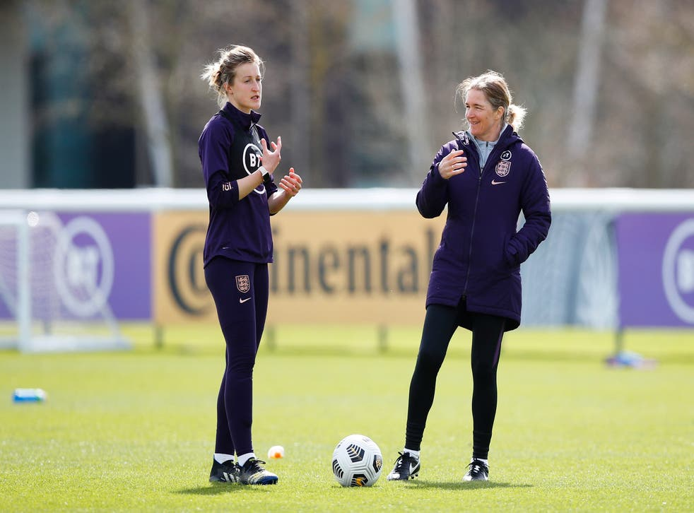 <p>Ellen White and Hege Riise during England training</p>