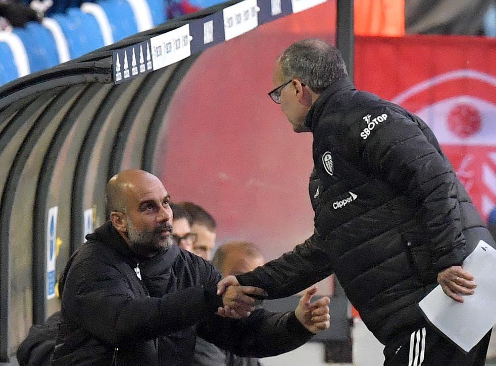 Manchester City coach Pep Guardiola (left) with Leeds boss Marcelo Bielsa