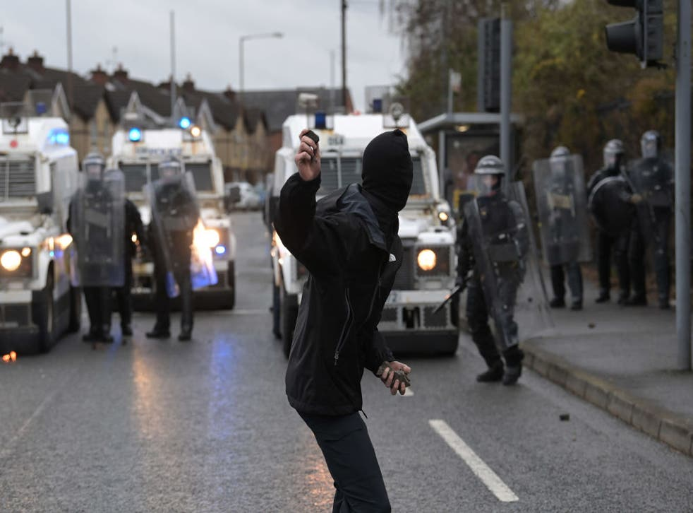 <p>A nationalist attacks police on Springfield Road, near the Peace Wall gates dividing nationalist and loyalist communities, on 8 April</p>