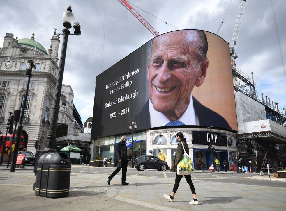 <p>A picture of the Duke of Edinburgh on the screen at Piccadilly Circus</p>