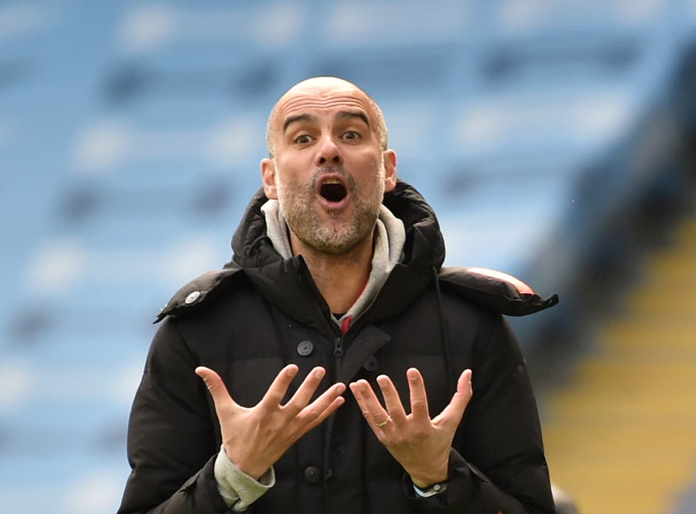 Manchester City coach Pep Guardiola reacts during his team's loss to Leeds