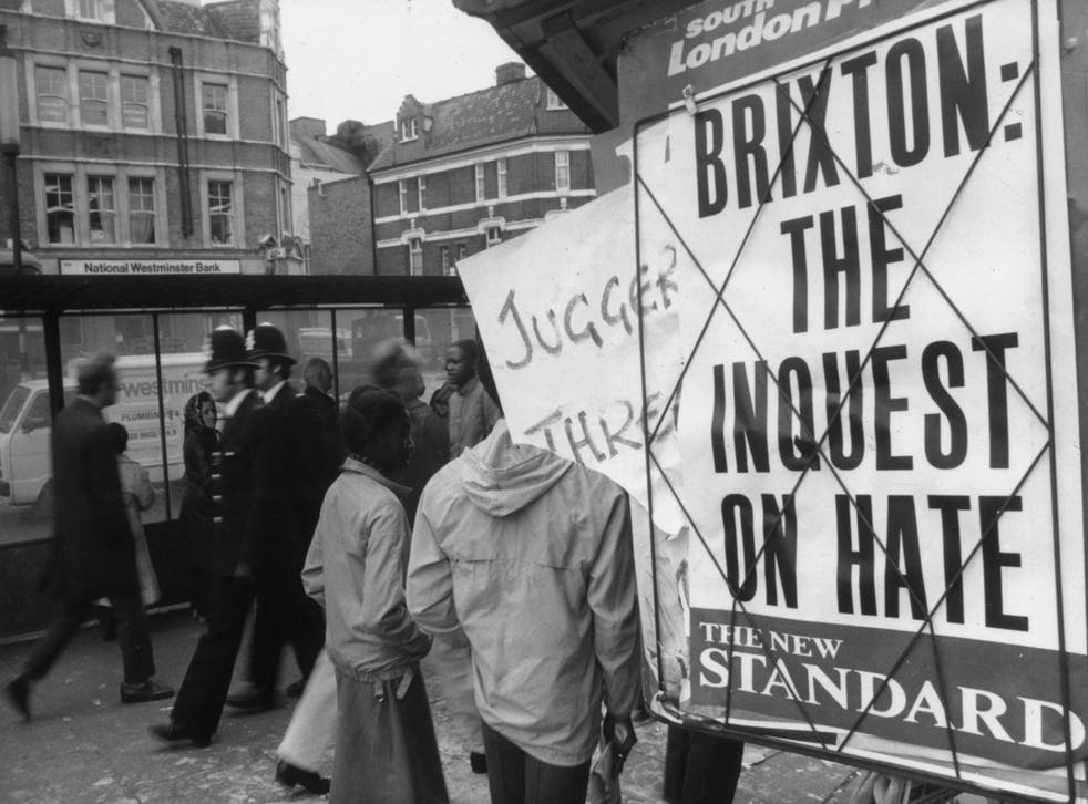 <p>Two policeman on the Brixton Road during the riots of 1981</p>