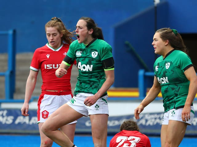 Hannah Tyrrell celebrates scoring Wales' seventh try against Ireland