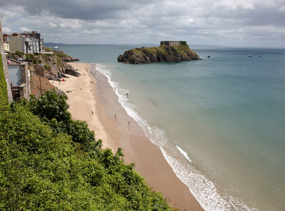 Tenby beach and island, where police say a man was saved after jumping into the sea