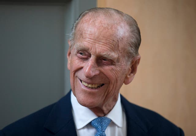 Prince Philip, the husband of Queen Elizabeth II, smiles after unveiling a plaque at the end of his visit to Richmond Adult Community College in Richmond