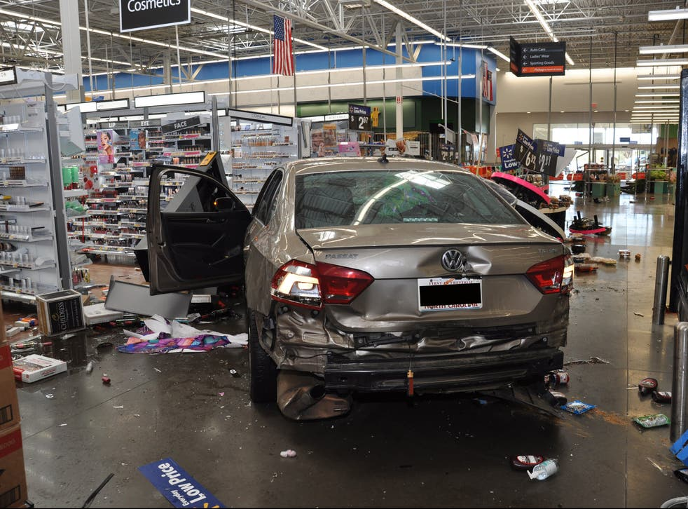 <p>Pictures released by Concord police show damage caused to a Walmart store on 2 April</p>