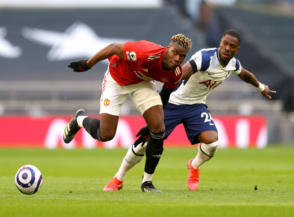 Paul Pogba contests for the ball with Serge Aurier